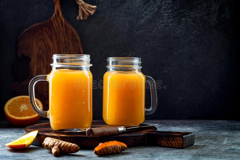 Immune boosting, anti inflammatory smoothie with orange, pineapple, turmeric. Detox morning juice drink. Clean eating stock image