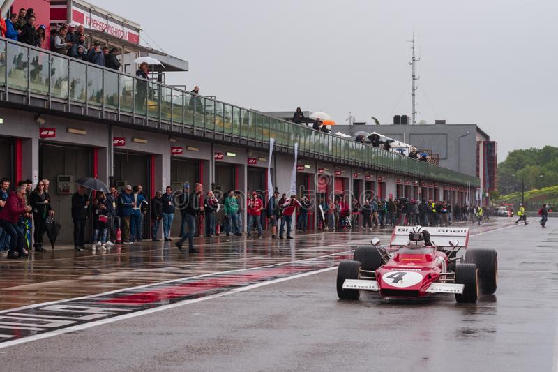 Imola, Italy 28 April 2019: a vintage Formula one car is leaving the pit lane during a rainy day. A vintage Formula one car is leaving the pit lane during a stock image