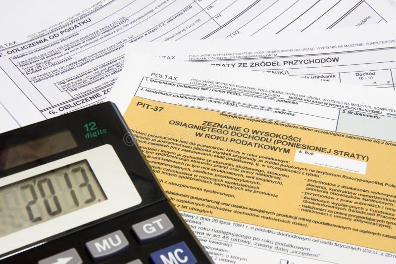 Impôts calculateurs en Pologne, devise de PLN photo stock