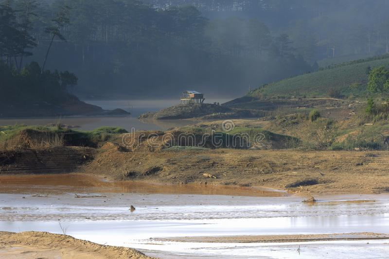 The impact of climate change, made dry land, water shortages. Lonely small house between rivers dry part 2 stock photo