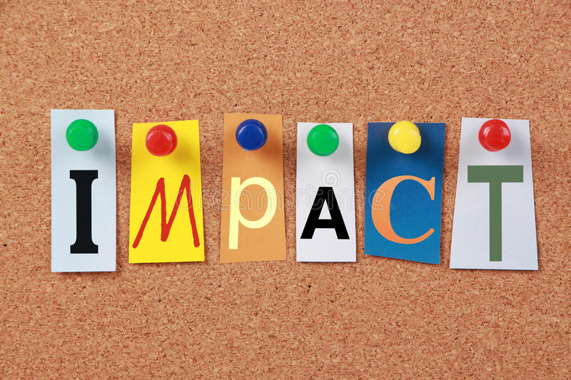 Impact Single Word. The word Impact in cut out magazine letters pinned to a corkboard stock photos