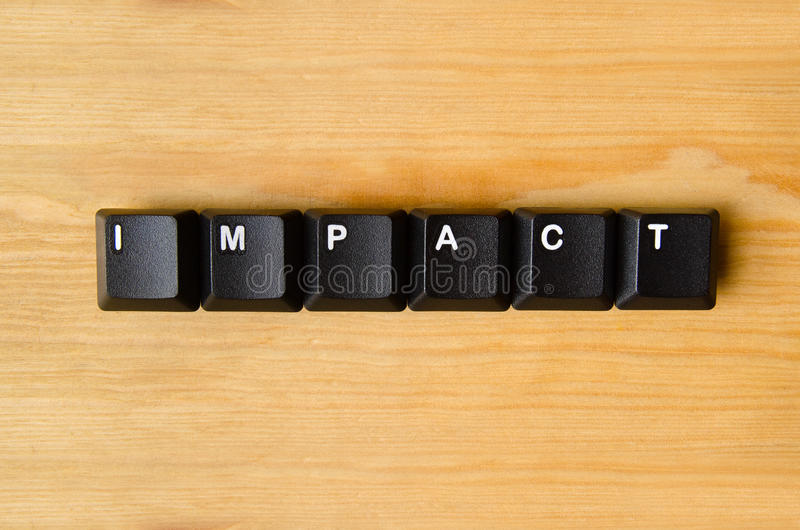 Impact word. With keyboard buttons stock photography