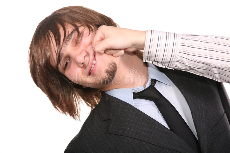 Impact on the young businessman. On a white stock image