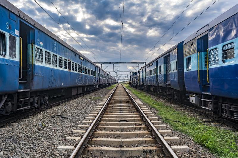 Endless Journey of Indian Railways. Impactful image displaying the Typical Indian Railways trains, positioned in perfect symmetry on a broad gauge railway track stock photos
