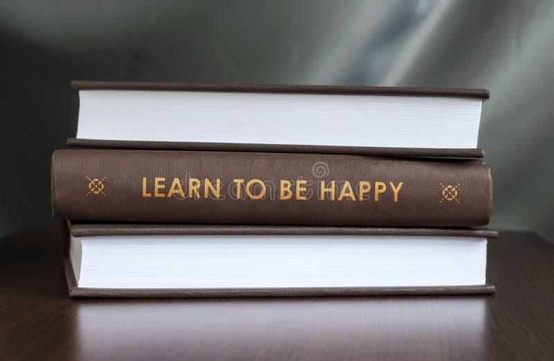 Impari essere felice. Prenoti il concetto. fotografia stock