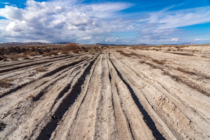 Impassable dirt off road, deep track. Scenery royalty free stock image