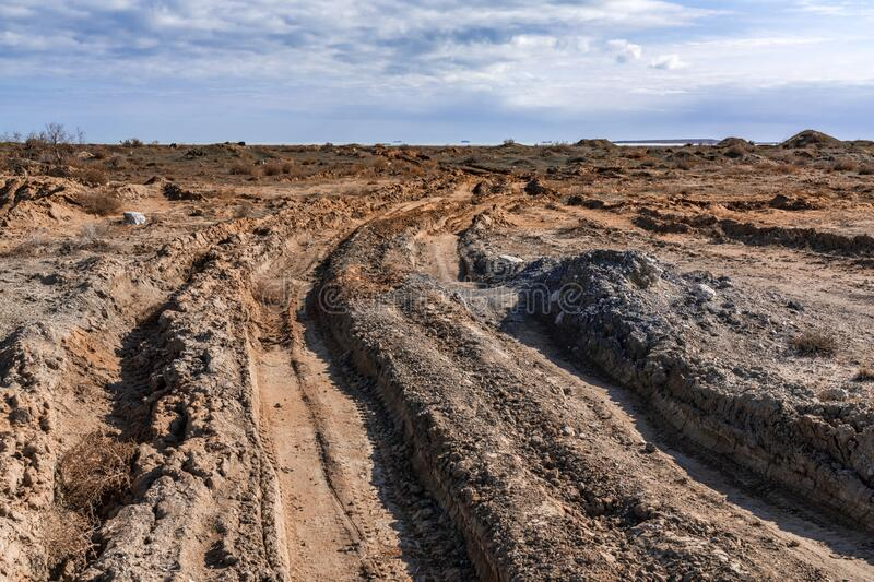 Impassable dirt off road, deep track. Scenery stock image