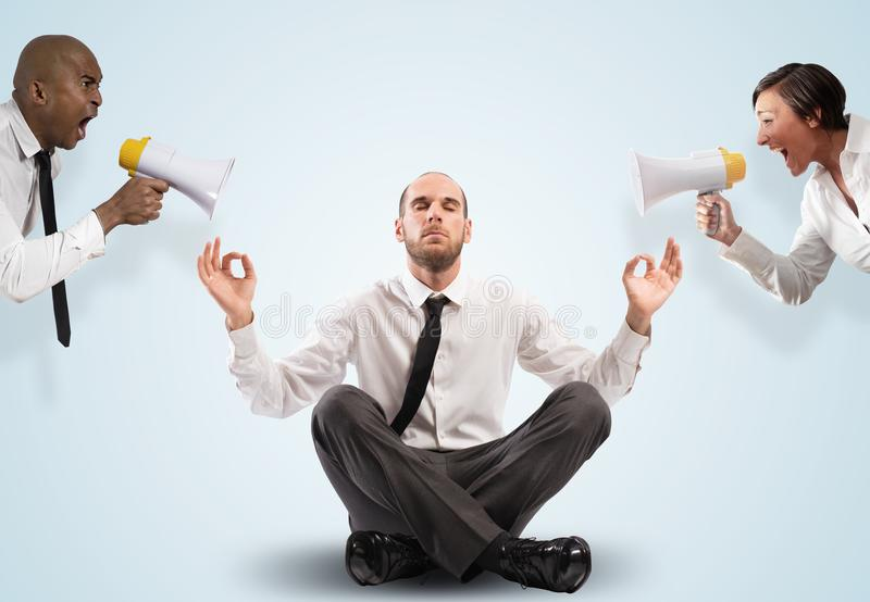 Impassive businessman despite the screams. Business men keeps calm in difficult situations stock photography