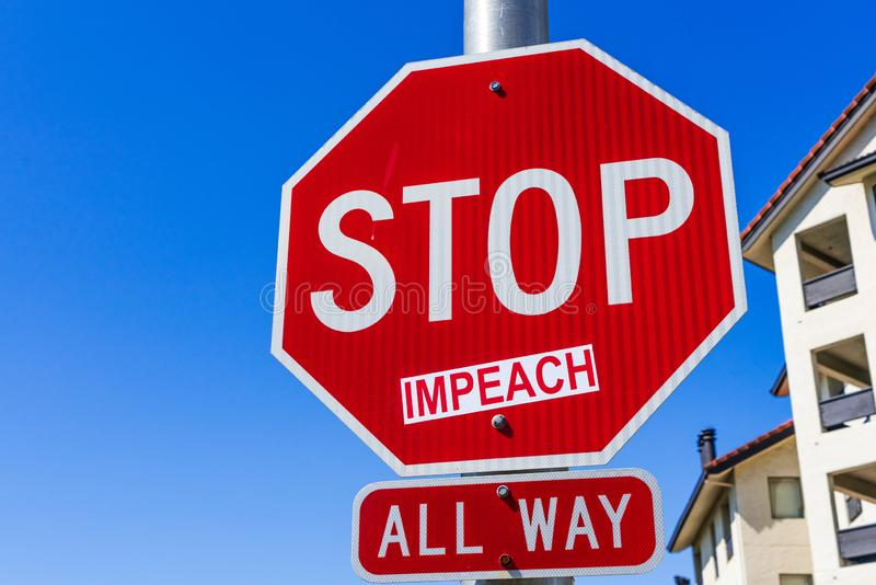 Impeach sticker applied on a Stop traffic sign; San Francisco bay area, California royalty free stock photos