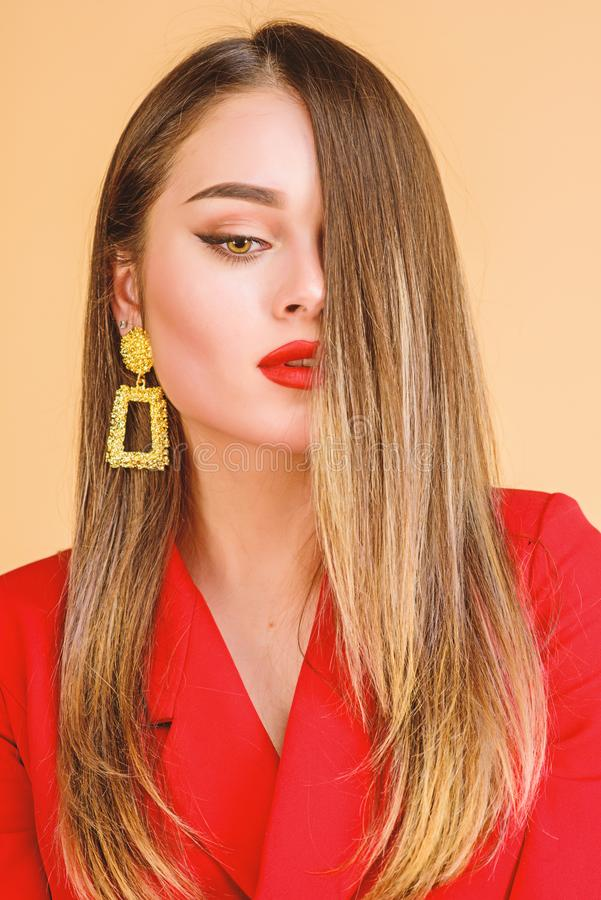 Impeccable makeup and perfect jewelry. Woman wear glamorous earrings. Fashion trend. Jewelry shop. Girl model long hair royalty free stock photo