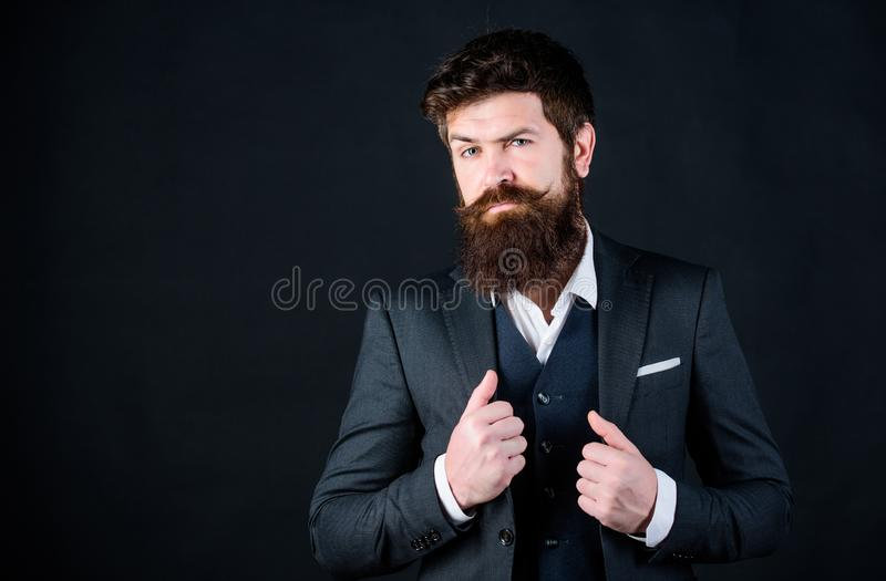 Impeccable style. Businessman fashionable outfit black background. Man bearded guy wear suit outfit. Perfect elegant royalty free stock image