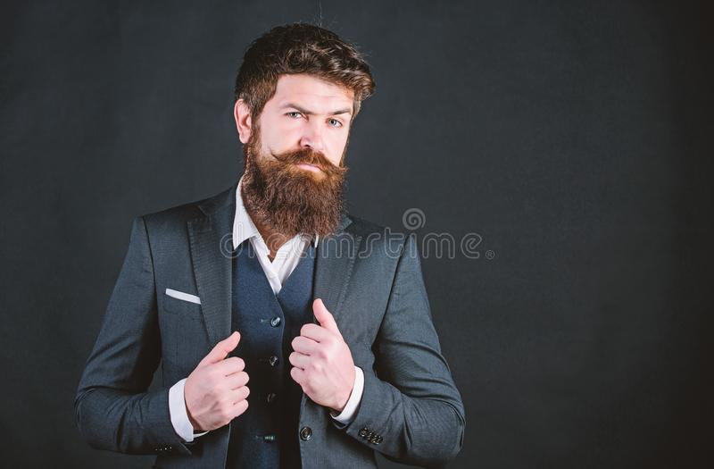 Impeccable style. Businessman fashionable outfit black background. Man bearded guy wear suit outfit. Perfect elegant. Tuxedo outfit. Elegancy and male style royalty free stock images
