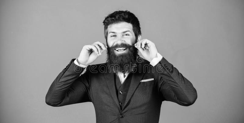 Impeccable style. Businessman fashionable outfit stand violet background. Elegancy and male style. Fashion concept. Guy. Wear formal outfit. Man bearded hipster royalty free stock photos