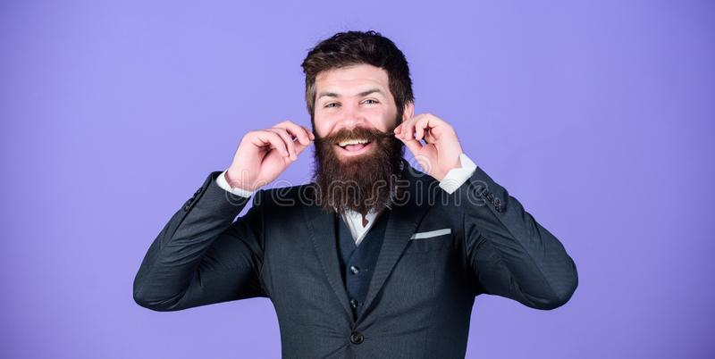 Impeccable style. Businessman fashionable outfit stand violet background. Elegancy and male style. Fashion concept. Guy. Wear formal outfit. Man bearded hipster royalty free stock images