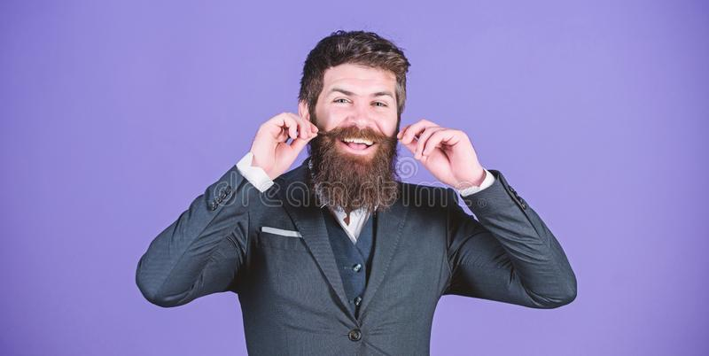 Impeccable style. Businessman fashionable outfit stand violet background. Elegancy and male style. Fashion concept. Guy. Wear formal outfit. Man bearded hipster royalty free stock photography
