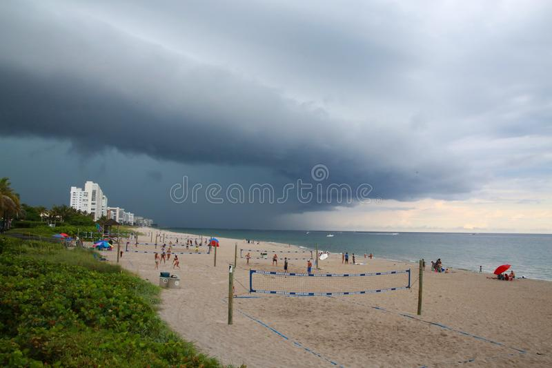 Impending Rain Storm at Deerfield Beach, Florida. A giant sheet of rain is imminent as it approaches the volleyball courts on Deerfield Beach, Florida in a dark royalty free stock image
