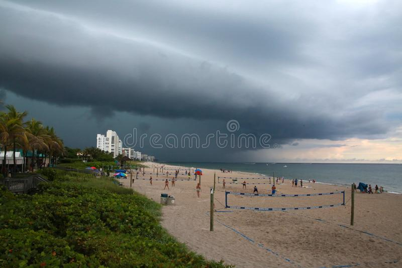 Impending Rain Storm at Deerfield Beach, Florida. A giant sheet of rain is imminent as it approaches the volleyball courts on Deerfield Beach, Florida in a dark royalty free stock images