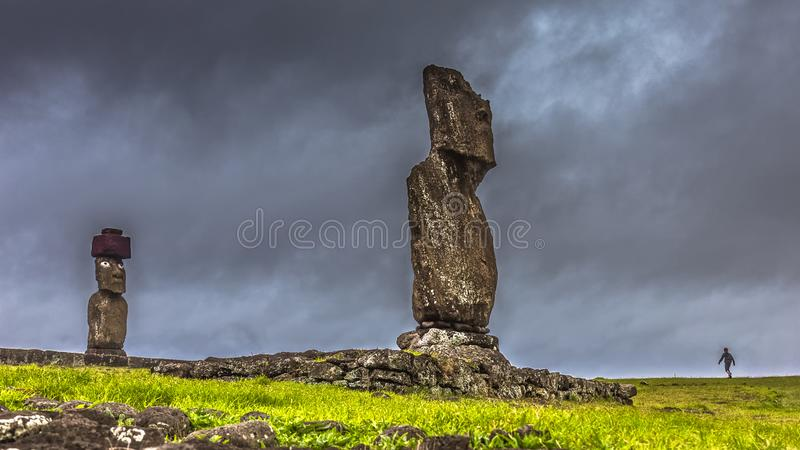 Impending Storm approaching Easter Island while a child is out playing royalty free stock photos