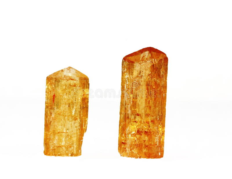 Imperial Topaz Crystals. Two deep orange natural Imperial topaz crystals. Topaz crystals are hydrated aluminium silicate of orthorhombic structure found in royalty free stock photos