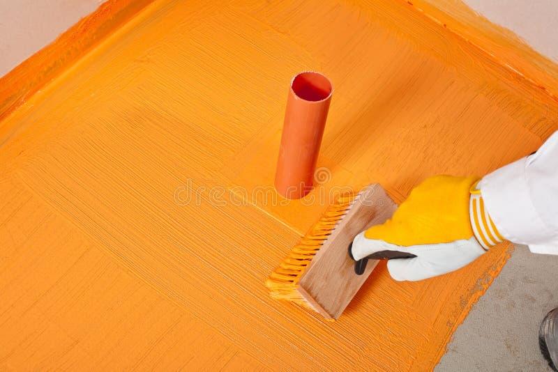 Impermeabilizzazione applicata spazzola fotografia stock