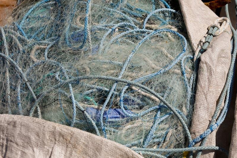 Impilato pescando le corde e le reti immagini stock libere da diritti