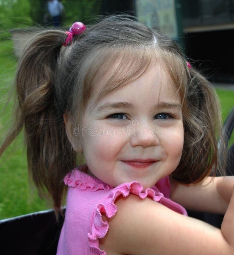 Impish улыбка на диком ребенке стоковое фото