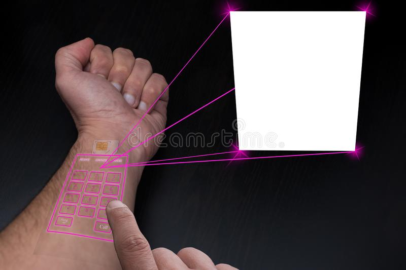Implanted SIM and telephone under the skin project a copy space for image o text royalty free stock photos