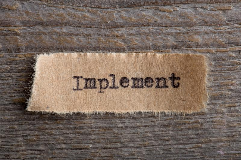 Implement - word on a piece of paper close up, business creative motivation concept. Implement- word on a piece of paper close up, business creative motivation stock images