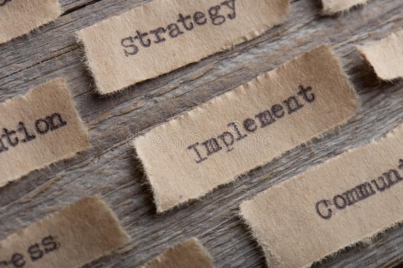 Implement - word on a piece of paper close up, business creative motivation concept. Implement- word on a piece of paper close up, business creative motivation royalty free stock photo