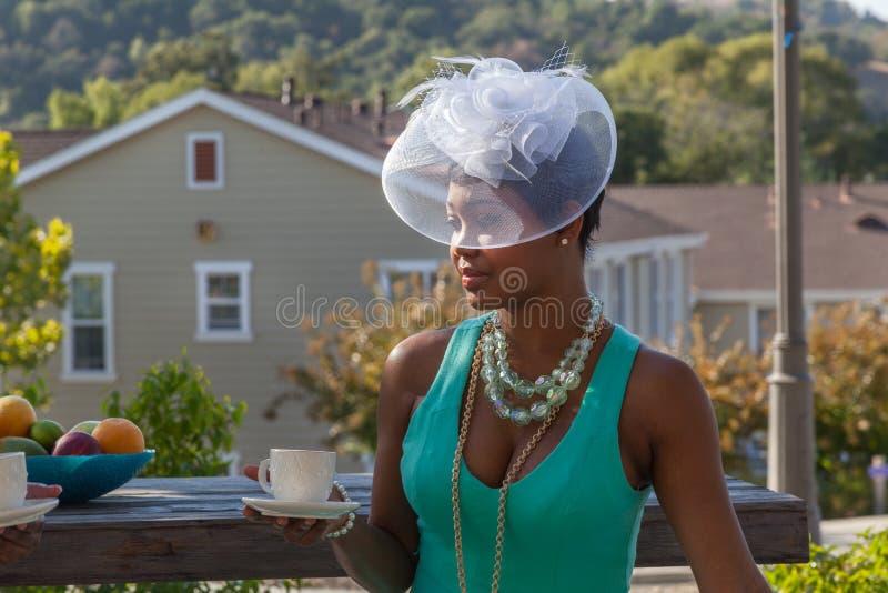 Implorando por Lola, por chapéus e por chá da parte alta fotografia de stock royalty free