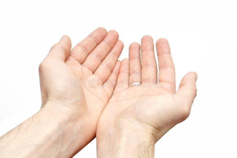 Implorar o sinal isolou as mãos de um pobre homem no fundo branco imagem de stock