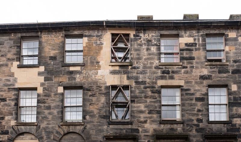 Imponująco architektura Glasgows z Za antyczną tenement kamienia pracą z zmuszającymi nadokiennymi lintels zdjęcie stock