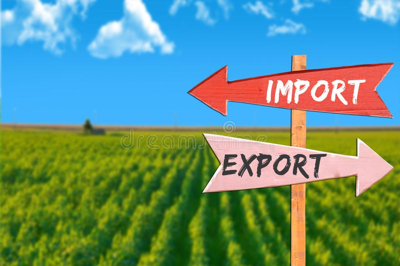Import versus export in agriculture. On directional signs royalty free stock image