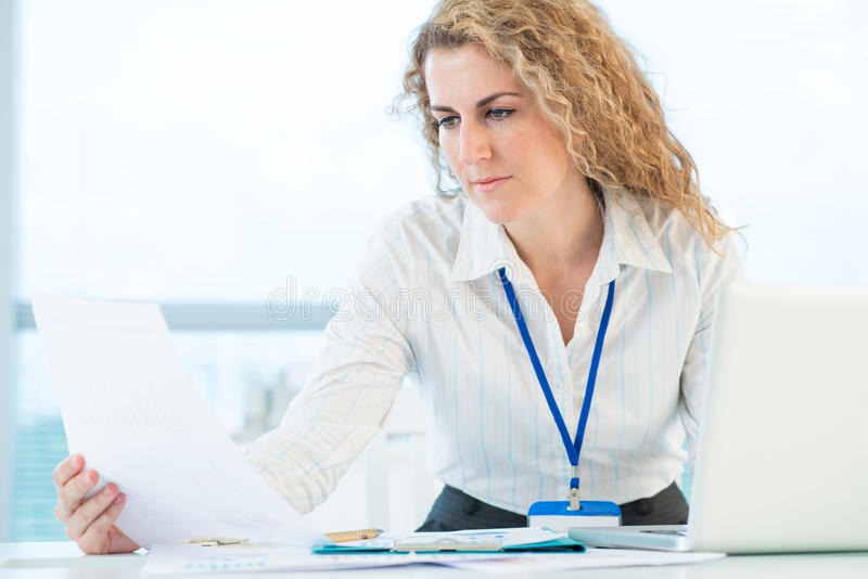 Important document. Image of a female office worker being concentrated on an important document stock photo