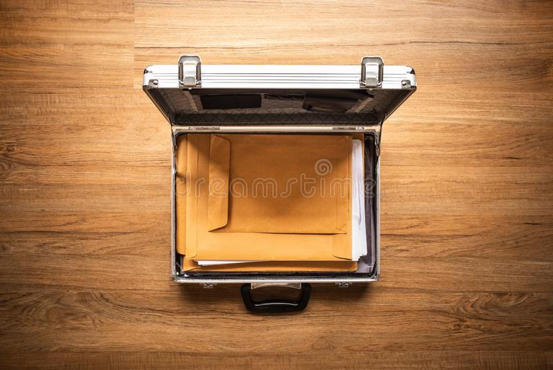 Important document paper in safety box metal on wood table.Business management.security concepts. Ideas stock photo