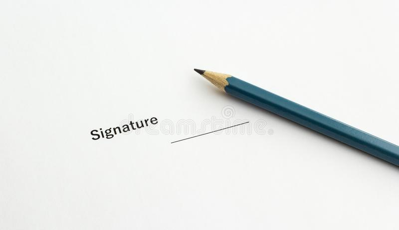 Important document for signing with a pencil, closeup stock images