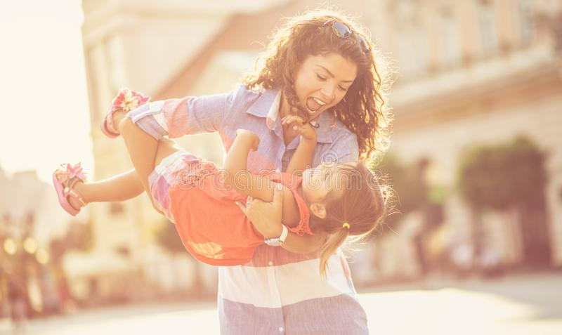 It is important for the mother to make the child happy. royalty free stock photo