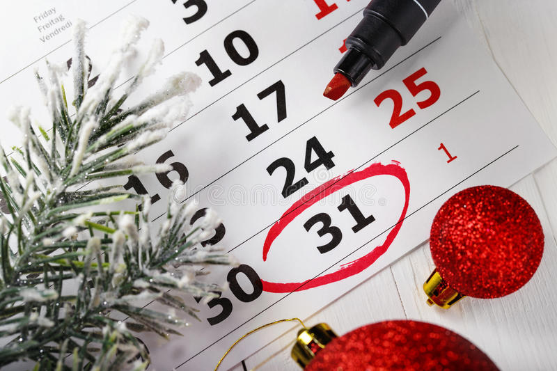Important New Year's Eve date which is led round in a calendar. A note for a meeting stock image