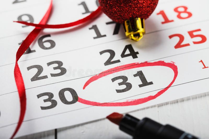 Important New Year`s Eve date which is led round in a calendar. A note for a meeting, closeup stock photos