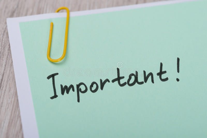 Important ! paper note with paperclip. Closeup of Important ! paper note with paperclip royalty free stock photos
