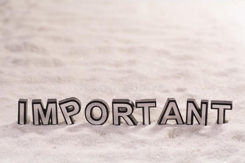 Important word on white sand royalty free stock images