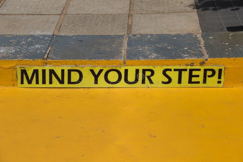Importe de su peligro del paso señal en amarillo foto de archivo libre de regalías