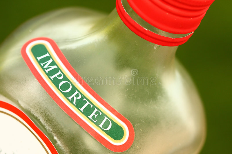 Imported alcohol. Bottle of imported alcohol with label royalty free stock photos