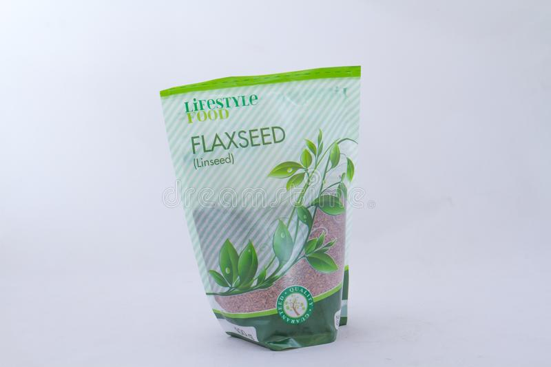 Imported flaxseed available in South Africa. Alberton, South Africa - September 29, 2019: a packet of imported Lifestyle Food flaxseed isolated on a clear royalty free stock photography