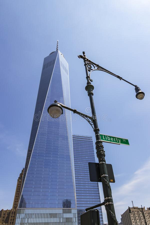The imposing building of One World Trade Center with a street light in the foreground with the street sign of Liberty St. New York royalty free stock images