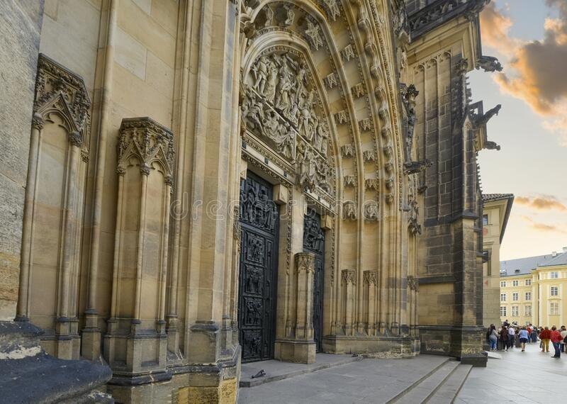 The imposing gothic facade and doors to St. Vitus Cathedral in the Prague Castle Complex in the Czech Republic.  royalty free stock photo