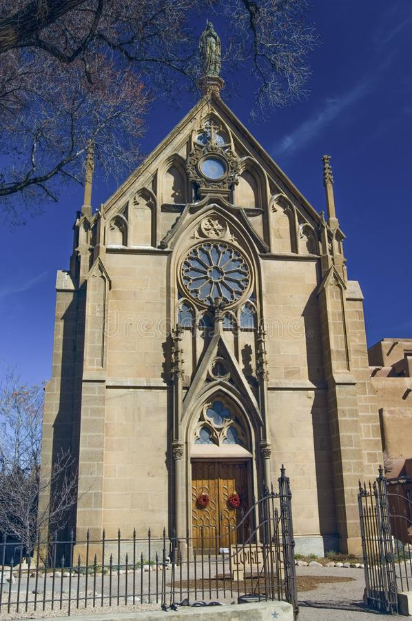 An imposing view of the Loretto Chapel under a blue sky in Santa Fe. royalty free stock photography
