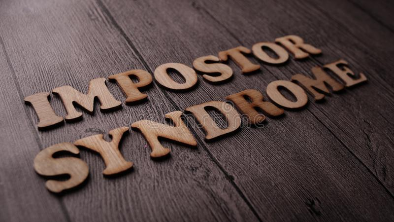 Impostor Syndrome, Mental Health Words Quotes Concept. Impostor Syndrome, Mental Health quotes, words typography top view lettering concept, imposter, psychology royalty free stock image