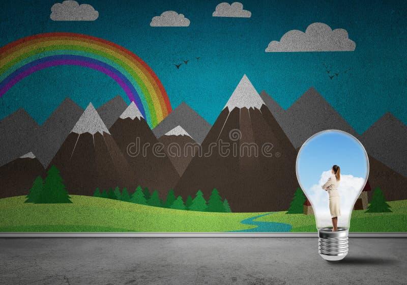 Imprenditrice intrappolata in una lampadina fotografie stock