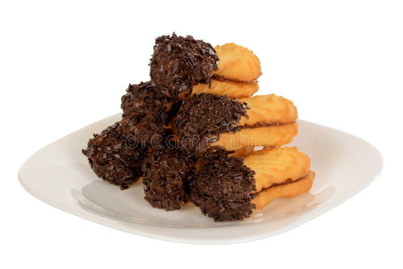 Imprense cookies, cookies dadas forma ovais enchidas com o creme do chocolate fotos de stock